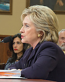 Former United States Secretary of State Hillary Rodham Clinton, a candidate for the 2016 Democratic Party nomination for President of the United States, testfies before the US House Select Committee on Benghazi on Capitol Hill in Washington, DC on Thursday, October 22, 2015.  Huma Abedin, a close aide, looks on from left.<br /> Credit: Ron Sachs / CNP<br /> (RESTRICTION: NO New York or New Jersey Newspapers or newspapers within a 75 mile radius of New York City)