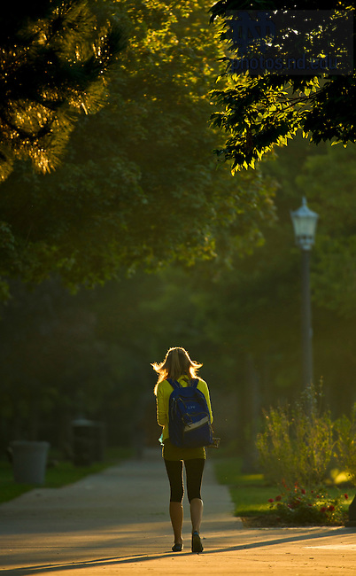 Sept. 24, 2013; A student walks to class early morning. Photo by Barbara Johnston/University of Notre Dame