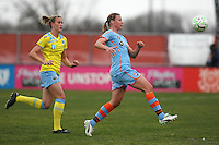 Philadelphia defender, Leigh Ann Robinson (7), chases Sky Blue striker, Laura Kalmari (21) as she attempts to collect the ball.    Sky Blue and Philadelphia played to a 2-2 tie in Sky Blue's season opener on April 10, 2011 in Piscataway, NJ.