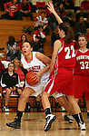SIOUX FALLS, SD: DECEMBER 20: Sydney Koel #52 from Washington looks to make a move against Becky Frick #22 from Yankton in the the first half of their game Friday night at Washington. (photo by Dave Eggen/Inertia)