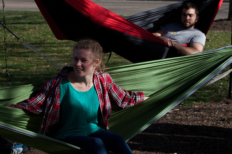 Alex Driehaus sits in a hammock with the Hammock Club outside of Morton Hall on Februrary 24, 2017.