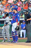 Tennessee Smokies catcher Cael Brockmeyer (34), Johnny Davis (17) and home plate umpire Brock Ballou during a game against the Biloxi Shuckers at Smokies Stadium on May 26, 2017 in Kodak, Tennessee. The Smokies defeated the Shuckers 3-2. (Tony Farlow/Four Seam Images)