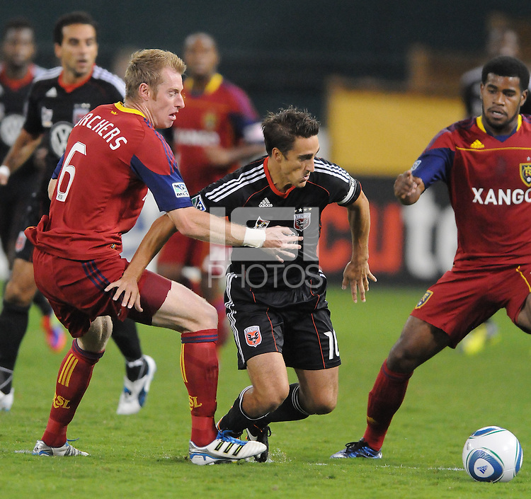 D.C. United forward Josh Wolff (16) shields the ball against Real Salt Lake defender Nat Borchers (6). D.C. United defeated Real Salt Lake 4-1 at RFK Stadium, Saturday September 24 , 2011.