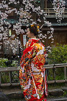 Japan, Kyoto. Woman in red wedding kimono.