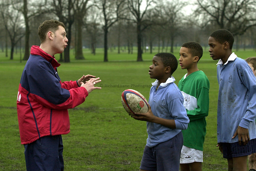 Photo:Ken Brown.22.1.2001 The RFU Youth Development Officers and Trevor Leota through his School of Hard Knocks attempt to recruit players to Rugby from inner-city London. Today they are at Bow Boys School London E3..RFU Coaches pass on advice