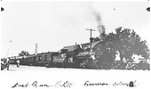 Excursion train stopped at Espanola depot.  Writing on print &quot;Last Run  C. L. H.  Excursion Special&quot;  This may be the last run of the engineer (CLH) who is posing for the camera.<br /> D&amp;RGW  Espanola, NM  1937-1939