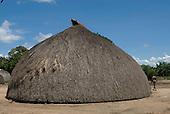 Xingu Indigenous Park, Mato Grosso State, Brazil. Aldeia Kamaiura. Exterior of traditional oca house showing end view.