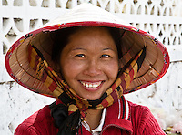 The silk chin strap for the straw hat is a frequently seen fashion accessory in Laos. (Photo by Matt Considine - Images of Asia Collection)