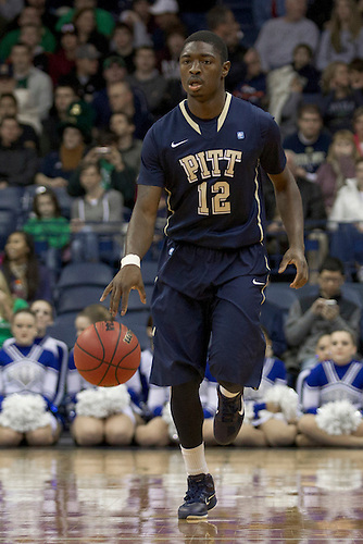 Pittsburgh guard Ashton Gibbs (#12) dribbles the ball in first half action during NCAA Men's basketball game between Pittsburgh and Notre Dame.  The Notre Dame Fighting Irish defeated the Pittsburgh Panthers 72-59 in game at Purcell Pavilion at the Joyce Center in South Bend, Indiana.