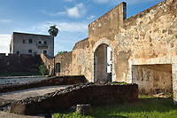Puerta de las Reales Atarazanas, or Gate of the Royal Shipyards, the entrance to a large complex of boatyards, warehouses and customs offices, in the Colonial Zone of Santo Domingo, Dominican Republic, in the Caribbean. The gateway was built in the mid 16th century and is one of the entrances to the Zona Colonial. It was restored in the 1970s. The site now houses the Museo de las Atarazanas. Santo Domingo's Colonial Zone is listed as a UNESCO World Heritage Site. Picture by Manuel Cohen