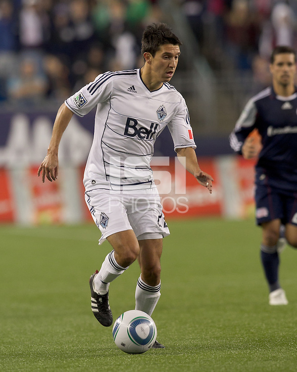 Vancouver Whitecaps FC midfielder Shea Salinas (22) dribbles. In a Major League Soccer (MLS) match, the New England Revolution defeated the Vancouver Whitecaps FC, 1-0, at Gillette Stadium on May14, 2011.