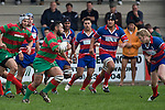 Maka Tatafu heads upfield as Bruce John lines up the tackle. Counties Manukau Premier rugby game between Waiuku & Ardmore Marist played at Waiuku on Saturday May 10th 2008..Ardmore Marist won 27 - 6 after leading 10 - 6 at halftime.