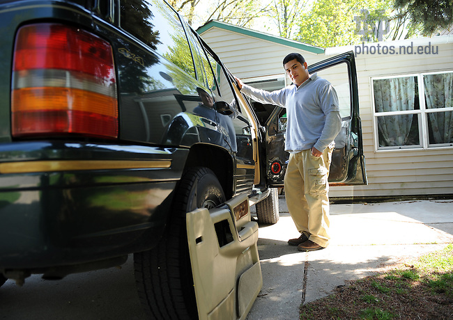 Marian High School junior Christopher Rodriguez works on his car stereo in the driveway of his home in South Bend.  Chris won first place and a cash prize of $500 in the Invention Convention Youth Business Plan Competition for a business plan for custom car audio installation.