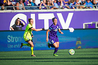 Orlando, Florida - Sunday, May 8, 2016: Orlando Pride forward Josee Belanger (9) dribbles away from Seattle Reign FC defender Elli Reed (7) during a National Women's Soccer League match between Orlando Pride and Seattle Reign FC at Camping World Stadium.