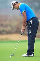 Cao Yi (CHN) putts on the 14th green during Friday's Round 2 of the 2014 BMW Masters held at Lake Malaren, Shanghai, China 31st October 2014.<br /> Picture: Eoin Clarke www.golffile.ie