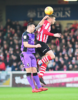 Lincoln City's Michael O'Connor battles with  Port Vale's Antony Kay<br /> <br /> Photographer Andrew Vaughan/CameraSport<br /> <br /> The EFL Sky Bet League Two - Lincoln City v Port Vale - Tuesday 1st January 2019 - Sincil Bank - Lincoln<br /> <br /> World Copyright © 2019 CameraSport. All rights reserved. 43 Linden Ave. Countesthorpe. Leicester. England. LE8 5PG - Tel: +44 (0) 116 277 4147 - admin@camerasport.com - www.camerasport.com