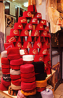 Tunis, Tunisia.  Display of fez and other traditional headgear/hats outside a shop in the bazaar..
