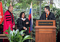 President Jonathan Veitch and Trustee Hector De La Torre '89 p'20 confer an Honorary Degree to speaker Maya Soetoro-Ng<br />