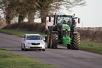 Car overtaking a tractor on a main road<br /> &copy;Tim Scrivener Photographer 07850 303986<br />      ....Covering Agriculture In The UK....