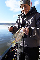 NWA Democrat-Gazette/FLIP PUTTHOFF<br />Tiffany Usrey shows one of several crappie she and her husband, Payton Usrey, caught Nov. 24 at Beaver Lake. The Usreys fish for crappie all year long at the lake.