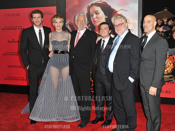 Jennifer Lawrence with Liam Hemsworth (left), Donald Sutherland, Josh Hutcherson, Philip Seymour Hoffman &amp; Stanley Tucci at the US premiere of their movie &quot;The Hunger Games: Catching Fire&quot; at the Nokia Theatre LA Live.<br /> November 18, 2013  Los Angeles, CA<br /> Picture: Paul Smith / Featureflash