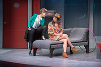 "Rosie Stevenson as DOMINATOR and Hilary Kang Oglesby as HELEN SPECTACULAR (with hat)<br /> Photo from the dress rehearsal of the Occidental College Department of Theater presentation of U-R-U by Julia Lederer, directed by Edgerton Guest Artist Jessica Kubzansky, Nov. 28, 2018 in Keck Theater.<br /> First daughter Helen Spectacular travels to Robo Island (Silicon Valley meets the Bermuda Triangle) on a secret mission to free thousands of robots from servitude. Absurdly comic and existentially chilling, U-R-U examines the societal obsession with progress at all costs and the decreasing worth of humanity in this increasingly artificial world.<br /> U-R-U is based on a 1920 science fiction play by the Czech writer Karel Čapek called R.U.R., which was the first time the word ""robot"" was used.<br /> (Photo by Marc Campos, Occidental College Photographer)"