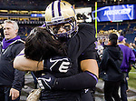 Washington Huskies linebacker Thomas Tutogi celebrates with a student after the Huskies upset the 7th Ranked Beavers 20-17 at CenturyLink Field in Seattle, Washington on October 27, 2012. ©2012. Jim Bryant Photo. ALL RIGHTS RESERVED.