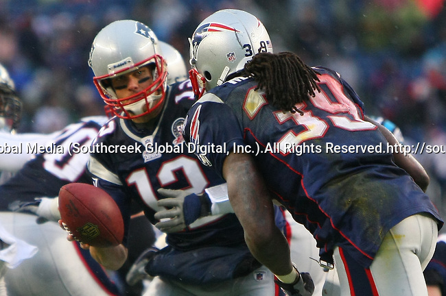 13December2009: Patriot quarterback Tom Brady #12 hands off to running back Laurence Maroney #39. The New England Patriots defeated the Carolina Panthers 20-10 at Gillette Stadium in Foxborough, Massachusetts.