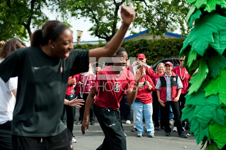 FRESNO, CA--Chiney Ogwumike and Nneka Ogwumike dance at the hotel parking lot before taking on Duke at the Save Mart Center for the West Regionals Championship of the 2012 NCAA Championships.