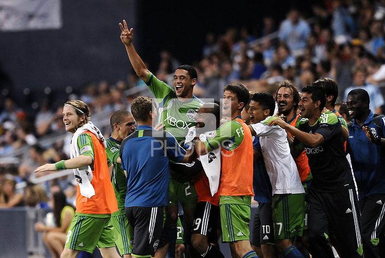 Lamar Neagle with arm raised celebrates his stoppage time game winning goal... Sporting Kansas City were defeated 1-2 by Seattle Sounders at LIVESTRONG Sporting Park, Kansas City, Kansas.
