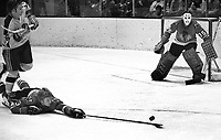Chicago Blackhawks Keith Magnuson reaches for puck,goalie Tony Esposito.. #16 Seals Frank Hughes or Tony Featherstone..(1971 photo/Ron Riesterer)