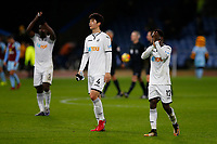 Wilfried Bony and Nathan Dyer of Swansea City applaud the fans as they leave the pitch following the Premier League match between Burnley and Swansea City at Turf Moor, Burnley, England, UK. Saturday 18 November 2017