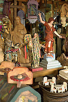 Goods in shop specializing in wood carvings. Angels and saints are amoung items shown. Patzcuaro Michoacan Mexico.