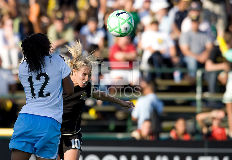 07 June 2009:  Leslie Osborne of the Gold Pride hits the ball in the air during the game against the Red Stars at Buck Shaw Stadium in Santa Clara, California.   FC Gold Pride tied Chicago Red Stars, 1-1.