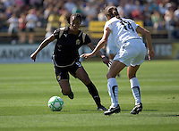 Kandace Wilson (9) controls the ball against Stephanie Cox (14) Los Angeles Sol defeated FC Gold Pride 2-0 at Buck Shaw Stadium in Santa Clara, California on May 24, 2009.