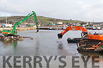 Strong arms<br /> ----------------<br /> Pictured last Monday are heavy machinery for dredging at Dingle harbour and marina