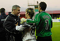 30/12/2006       Copyright Pic: James Stewart.File Name : sct_jspa11_falkirk_v_inverness.FALKIRK'S HEAD STEWARD AND KEEPER MARK BROWN HOLD BACK IAIN BLACK AFTER BEING SENT OFF AT HALF TIME....James Stewart Photo Agency 19 Carronlea Drive, Falkirk. FK2 8DN      Vat Reg No. 607 6932 25.Office     : +44 (0)1324 570906     .Mobile   : +44 (0)7721 416997.Fax         : +44 (0)1324 570906.E-mail  :  jim@jspa.co.uk.If you require further information then contact Jim Stewart on any of the numbers above.........