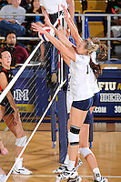 16 October 2010:  FIU right side hitter Ines Medved (11) attempts to block a shot in the second set as the Western Kentucky Hilltoppers defeated the FIU Golden Panthers, 3-2 (25-19, 23-25, 25-20, 25-27, 15-13), at the U.S Century Bank Arena in Miami, Florida.