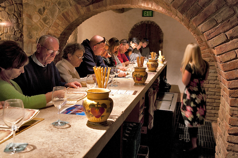 People wine tasting at Castello di Amorosa. Napa Valley, California. Property relased
