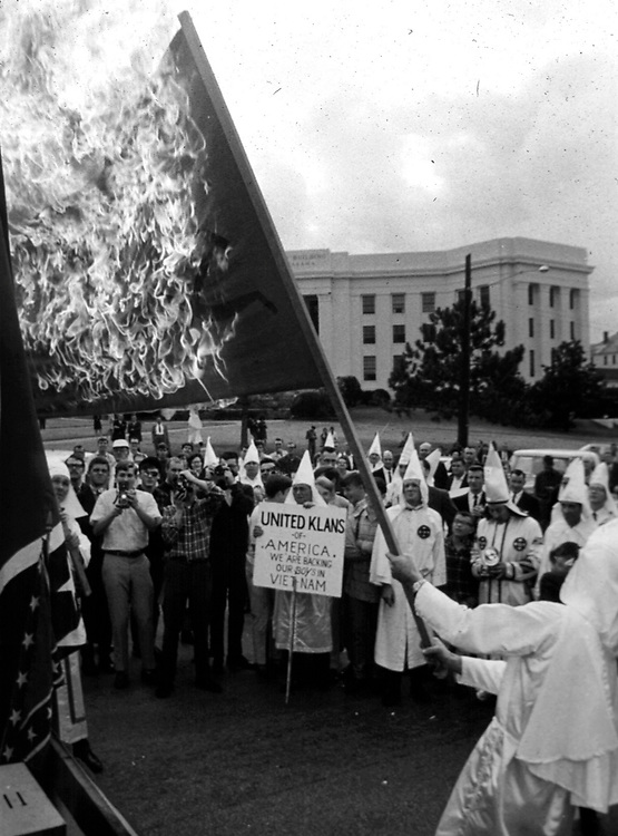 "A mock ""Communist flag"" is burned on the steps of Capitol at end of a Ku Klux Klan parade along Dexter Ave. in Montgomery, Ala in December, 1967 to protest Dr. Martin Luther King Jr speaking at Dexter Ave. Baptist Church on Anniversary of Montgomery Bus Boycott. (Photo by Jim Peppler published in The Southern Courier Dec. 16, 1967). Copyright Jim Peppler/1967. This and over 10,000 other images are part of the Jim Peppler Collection at The Alabama Department of Archives and History:  http://digital.archives.alabama.gov/cdm4/peppler.php"