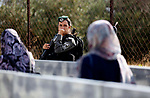 Palestinians make their way through an Israeli checkpoint along Israel's controversial separation barrier to attend the third Friday prayer of the holy fasting month of Ramadan in Jerusalem's Al-Aqsa mosque, in Bethlehem in the occupied West Bank, on June 1, 2018. Ramadan is sacred to Muslims because it is during that month that tradition says the Koran was revealed to the Prophet Mohammed. The fast is one of the five main religious obligations under Islam. Muslims around the world will mark the month, during which believers abstain from eating, drinking, smoking and having sex from dawn until sunset. Photo by Wisam Hashlamoun