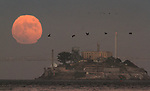 July full moon rising over Alcatrz Island in the San Francisco Bay,