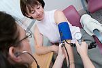 Patient having blood pressure taken. MR
