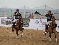 Algy Sim of Barbarians gives Martin Young of Barbarians a thumbs up after the Scotland v  Barbarians  match at the Asahi Beach Polo Championship  at Sandbanks, Poole, England on 10 July 2015. Photo by Andy Rowland.