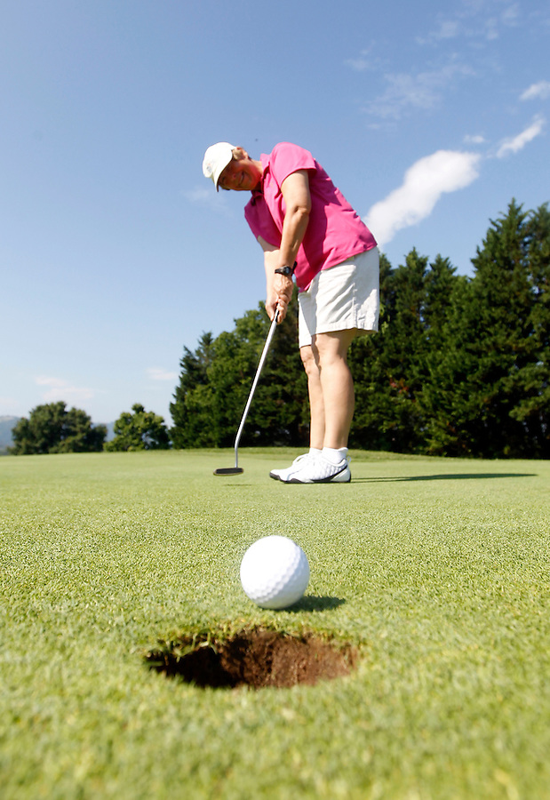 A woman golfs on the scenic fairways of the Meadowcreek Golf Course in Charlottesville, VA. Photo/Andrew Shurtleff