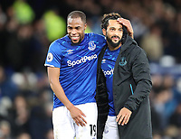 11th January 2020; Goodison Park, Liverpool, Merseyside, England; English Premier League Football, Everton versus Brighton and Hove Albion; Djibril Sidibe of Everton celebrates with Theo Walcott as the match ends in a 1-0 Everton victory - Strictly Editorial Use Only. No use with unauthorized audio, video, data, fixture lists, club/league logos or 'live' services. Online in-match use limited to 120 images, no video emulation. No use in betting, games or single club/league/player publications