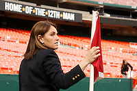 Referee Sandra Serafini inspects the corner flag before the match. The women's national team of the United States defeated Canada 6-0 during an international friendly at Robert F. Kennedy Memorial Stadium in Washington, D. C., on May 10, 2008.
