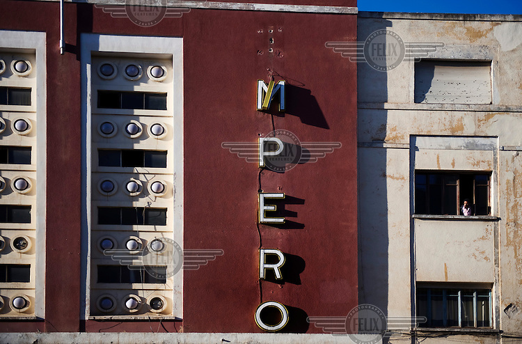 The Cinema Impero building on Harnet Avenue in Asmara. It was designed by architect Mario Messina and built in 1937. The city is a showcase of 1930s Italian Art Deco architecture that was initially brought to the region by colonial-era Italians, the style continued to flourish into the 1960s as local architects furthered the distinctive designs.
