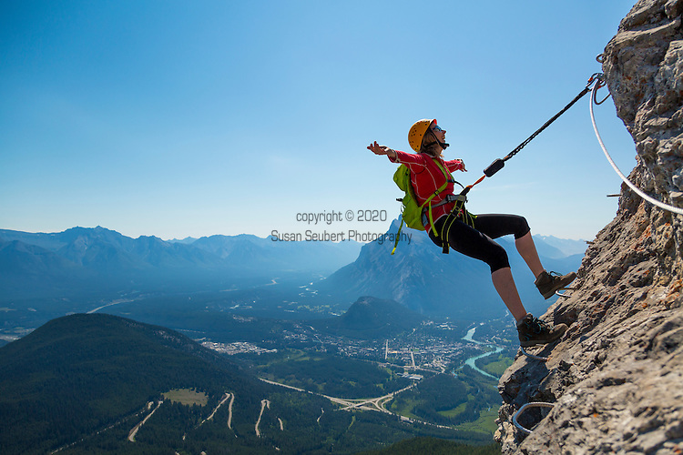The Via Ferrata on Mt. Norquay, Banff National Park, Canada.  Via Ferrata (Italian for Iron Road) is a trail making method used in the mountains to make passage easier and more secure. It is done by a installing steel steps, handles, ladder rungs, and a steel cable in the places where the trail steepens. Travellers are secured to the rock by wearing a harness that is always attached to the steel cable.<br /> The Norquay VF is designed to accommodate beginners seeking a taste of the alpine, and to accommodate folks who already have a little alpine experience. The Norquay Via Ferrata is located on the cliffs above The Cliffhouse Bistro at the top of the North American Chairlift.<br /> In total there&rsquo;s about 300m of Via Ferrata  and about 1350m of trail.
