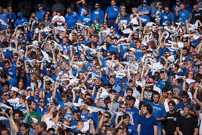 The UK student section cheers during the first half of the Kentucky Wildcats game against the Mississippi State Bulldogs at Commonwealth Stadium on Saturday, October 25, 2014 in Lexington, Ky. Mississippi leads Kentucky 17-10. Photo by Adam Pennavaria | Staff